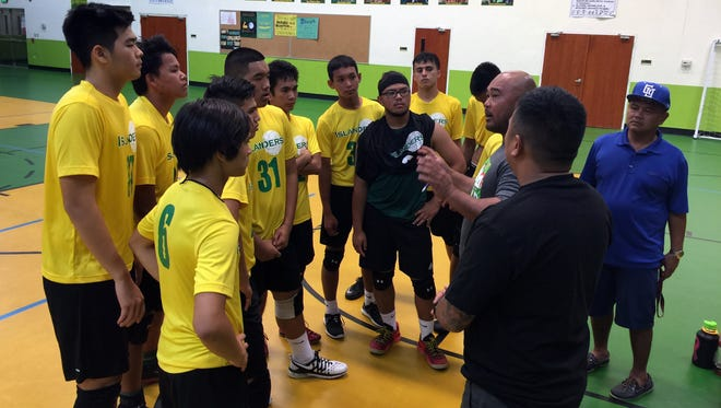 JFK Islanders meet with coach Alden Bautista after their IIAAG boys high school volleyball league playoff game against the Simon Sanchez Sharks at JFK on Friday, May 6. The Islanders won in three sets to advance.