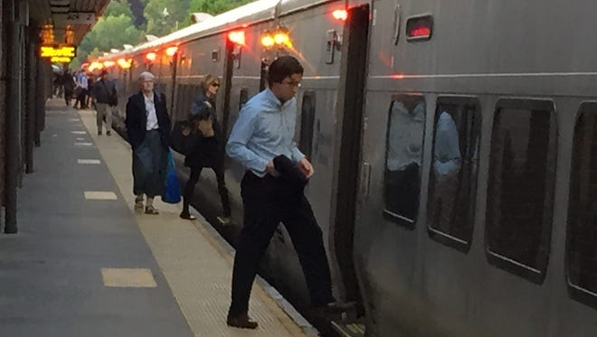 Passengers board a New York City-bound train at the White Plains station.