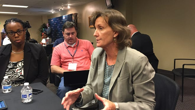 Conference USA commissioner Judy MacLeod fields questions at Monday's first day of C-USA Media Days in Irving, Texas.
