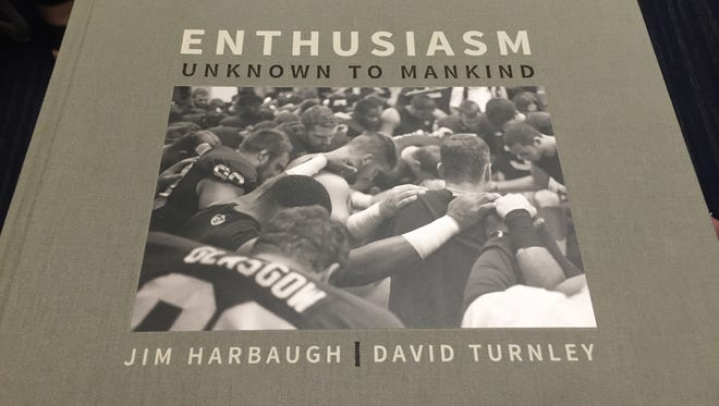 """""""Enthusiasm Unknown to Mankind,"""" the photo book collaboration by U-M football coach Jim harbaugh and photographer David Turnley."""