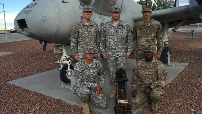 Soldiers from the 204th Military Intelligence Battalion won the third annual Staff Sgt. Joshua Mills Commando Competition at Fort Bliss. Pictured are: from left, top row, 1st Lt. Sean Toal, Capt. Joshua Hicks and Spc. Ian Inman and kneeling, Sgt. Miguel Gonzalez and Staff Sgt. Vanearl  Glenn. First Lt. Tyler Spease is not shown.