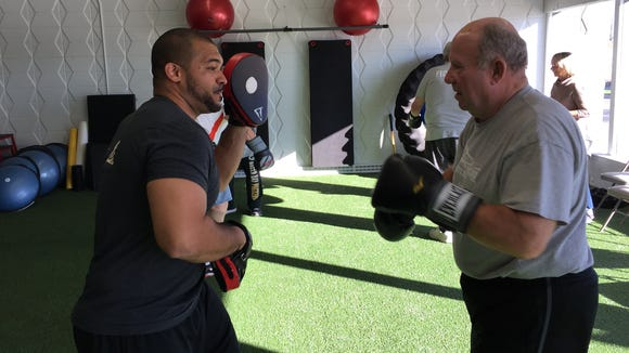 Marv Staehle boxes with trainer Darrell Jack to improve his muscle function in the Rock Steady Boxing program.