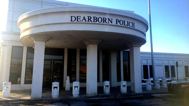 Dearborn Police arrested two men who came to the police station wearing masks and carrying rifles.
