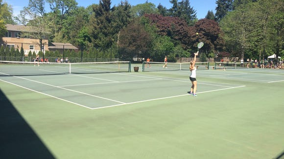 West Salem's Anya Gerasimova wins her match Wednesday at the district meet.