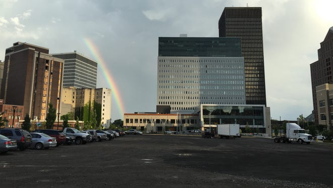 A rainbow shines near Parcel 5 in downtown Rochester after a shower July 1, 2016. What happens to the site could go a long way to changing the health of the downtown neighborhood.