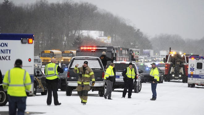 Emergency personnel work the scene of a multi-vehicle pileup on I-94 in southern Michigan, on Friday, March 9, 2018