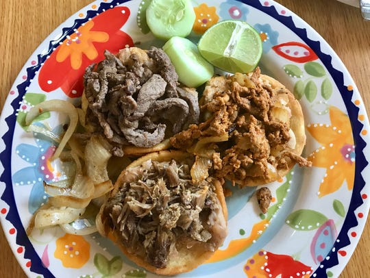 A trio of sopes from from Tacos San Miguel II in Cape