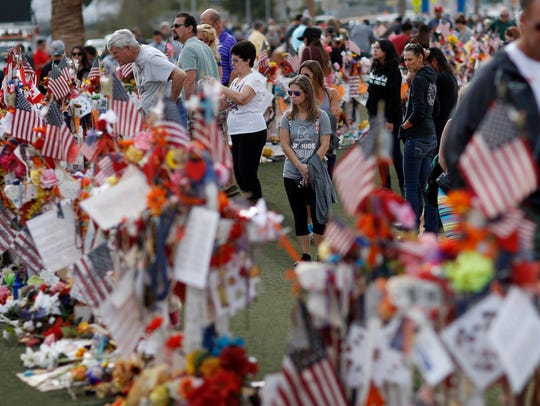 People visit a makeshift memorial honoring the victims of the Oct. 1, 2017, mass shooting on Nov. 12, 2017, in Las Vegas.