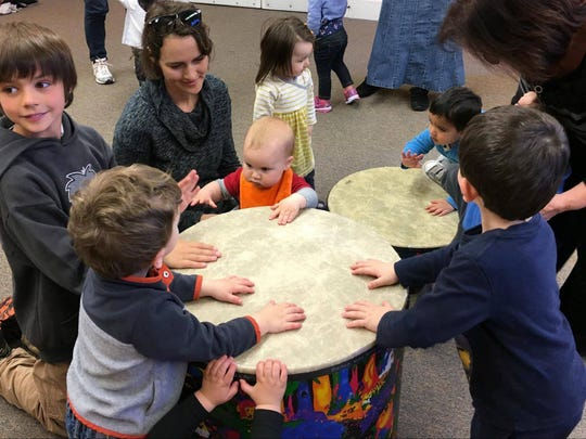 Children explore percussion at a Dancing Bears Music class.