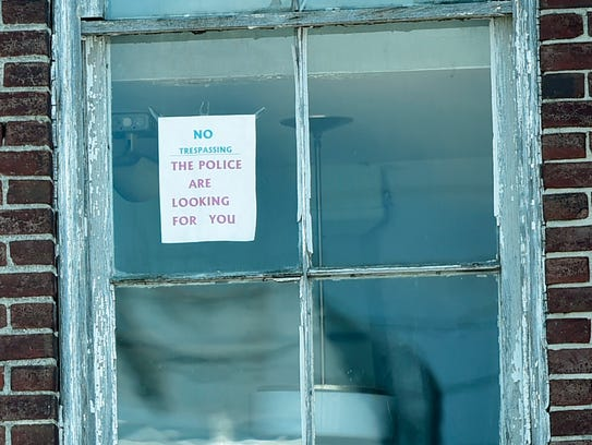 An old sign warns would be burglers to stay out of
