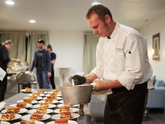 Chef Matt Smith ladles a simple tomato sauce over vegetable lasagna during Coloradoan Experiences' Pop-Up Pairing at the The Articulate Thursday, Oct. 20, 2017.