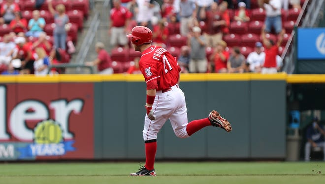 Reds infielder Todd Frazier rounds first base after hitting a two-run home run - his 14th of the season - in the first inning Thursday against the Dodgers at GABP.