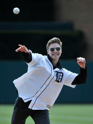 Josef Newgarden throws out the first pitch Tuesday at Comerica Park.