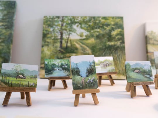 Hugh Webb carved small easels which are then painted by Barbara.
