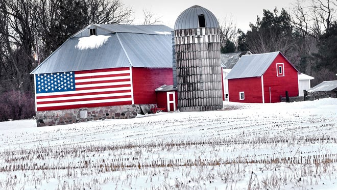 Fresh-fallen snow surrounds brightly painted farm buildings Tuesday, March 6, near St. John's University.