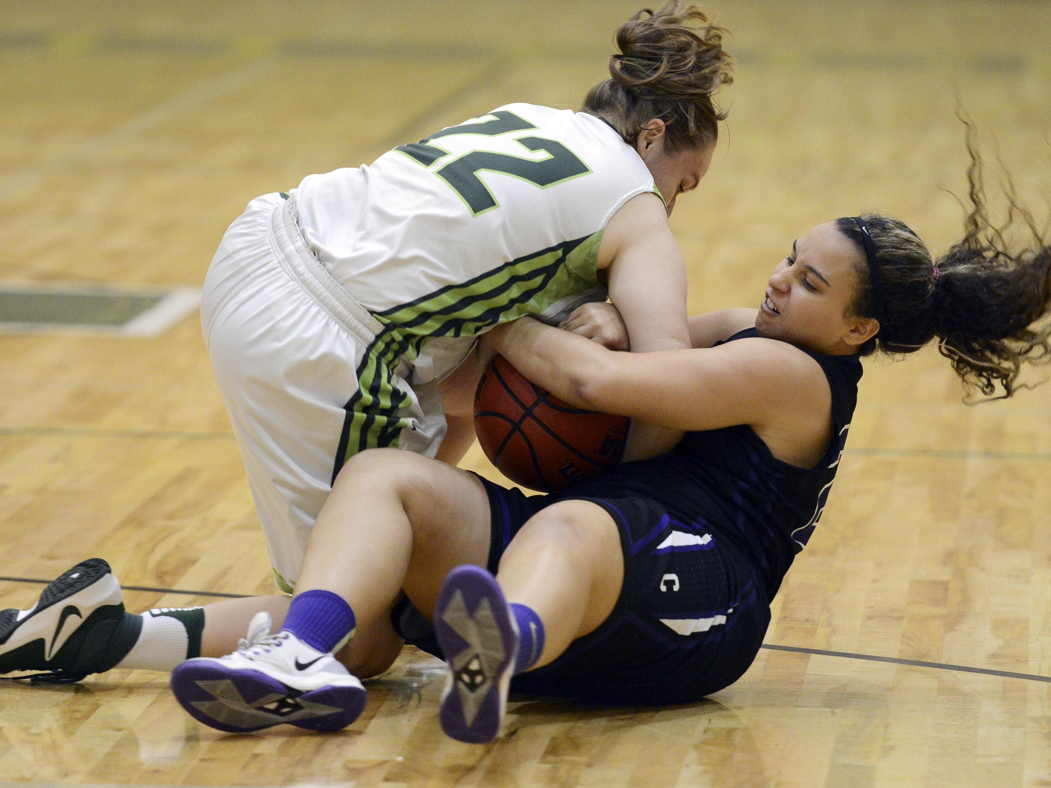 Caitlyn Hoffine of Viera and Alexa Robeants of Celebration battle for a loose ball during Friday's game in Viera.