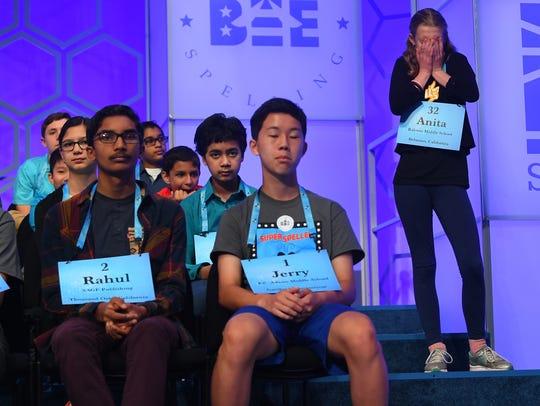 Anita Beroza waits for her turn before she spelled
