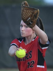 Mollie Bartlett (12) of Lourdes winds up for the pitch during Tuesday's WIAA Division 3 regional softball game.