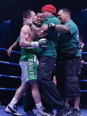 Camden's Jason Sosa celebrates his victory over Javier Fortuna of Dominican Republic during their WBA Mini Flyweight Eliminator boxing match at Capital Indoor Stadium on June 24, 2016 in Beijing, China.