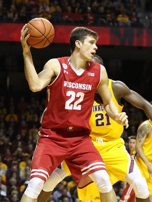 Wisconsin Badgers forward Ethan Happ often wears down his opponent.