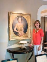 Dee with a potrait of her grandmother, Rachel Mignon