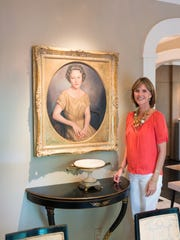 Dee with a potrait of her grandmother, Rachel Mignon