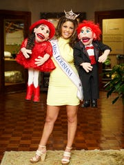 Miss Louisiana 2017 Laryssa Bonacquisiti performs with Lucky (far right) and Lucy.