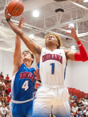 Indiana Senior All-Star Romeo Langford of New Albany H.S. and committed to Indiana puts up a shot as Indiana Junior All Star Luke Bumbalough of New Castle H.S. defends.