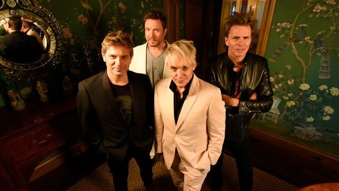 Roger Taylor,  Simon LeBon, Nick Rhodes,  John Taylor of Duran Duran pose together.