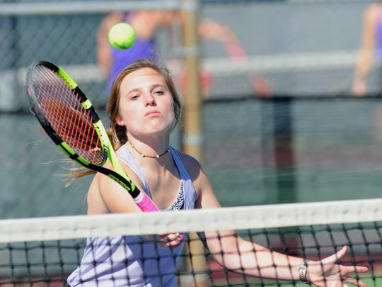 Wylie's Andrea McMillan tracks down a shot at the net during a girls double match against a team from Cooper. McMillan and teammate Elle Schroeder beat Cooper's Josephine Bandora and Liana Burris 6-1, 6-0 at the Cougar Classic on Friday, March 2, 2018 at Rose Park Tennis Center.