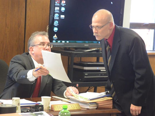 Defense attorney Alan Koenig and Assistant Prosecutor Mike Kanaby confer during the hearing.