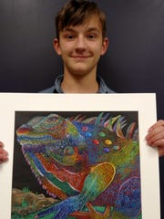 "Merrill freshman Makyah Goetsch poses with his award-winning piece ""Lizard"" to be featured at the Wisconsin State Education Convention in January 2017."