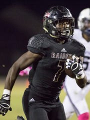 Michael Carter (7) runs for a big gain during the football game against American Heritage at Navarre High School on Friday, October 21, 2016.