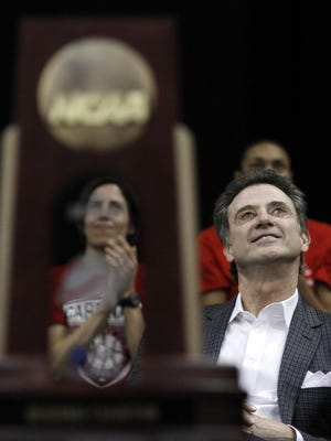 Rick Pitino celebrates. April 10, 2013