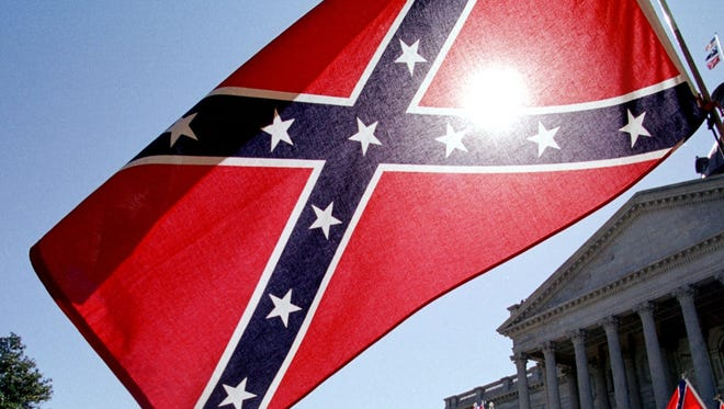 COLUMBIA, SC - APRIL 6:  Confederate flag supporters demonstrate on the north steps of the capitol building 06 April, 2000 in Columbia, SC.