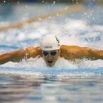 Tom Shields swims the 100-meter butterfly during the preliminaries at the Mecklenburg County Aquatic Center.