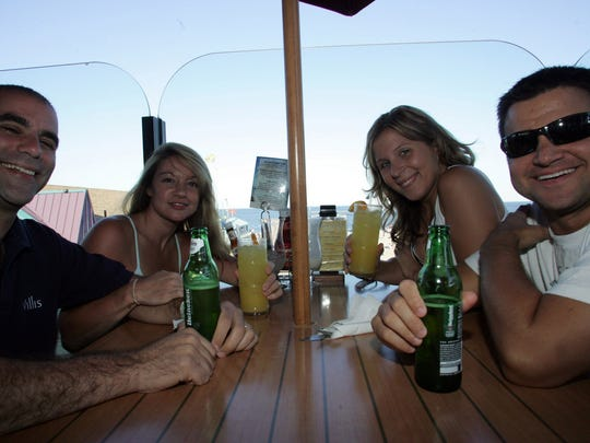 Visitors to Point Pleasant Beach from Staten Island enjoy drinks at the Boardwalk Bar and Grill.