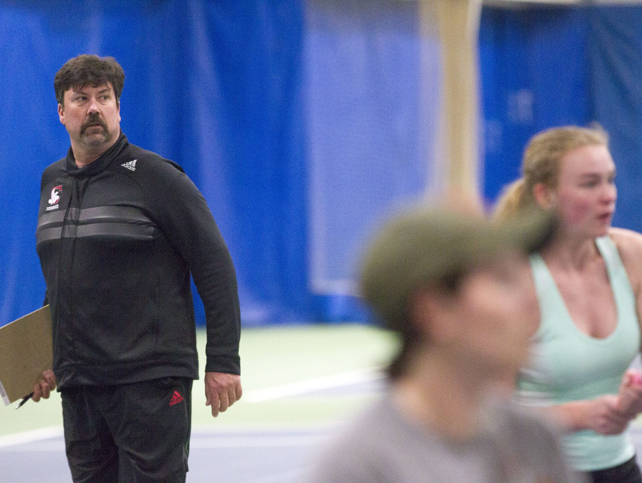 City High head coach Fred Pedersen watches his team practice inside the North Dodge Athletic Club on Tuesday.
