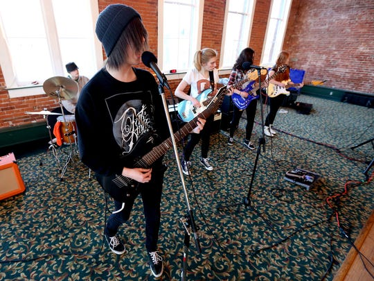 Kids rehearse for the River City Rock Star Academy at the Reed Opera House in Salem.