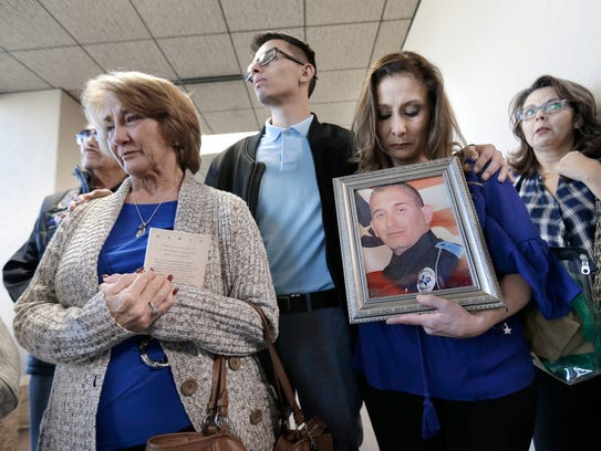 The family of El Paso police Officer David Ortiz is