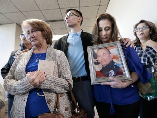 The family of El Paso police Officer David Ortiz is