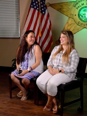 On Friday, Dec. 27, 2019, Jesselyn Mesa, left, and Amber Savoie reunite for the first time after surgery during an interview at the Palm Beach County Sheriff's Office headquarters in suburban West Palm Beach.