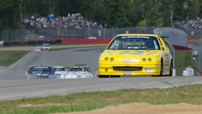 Florida driver Peter Shadowen leads the pack in Saturday's GT-Lite race at the Mid-Ohio Sports Car Course.