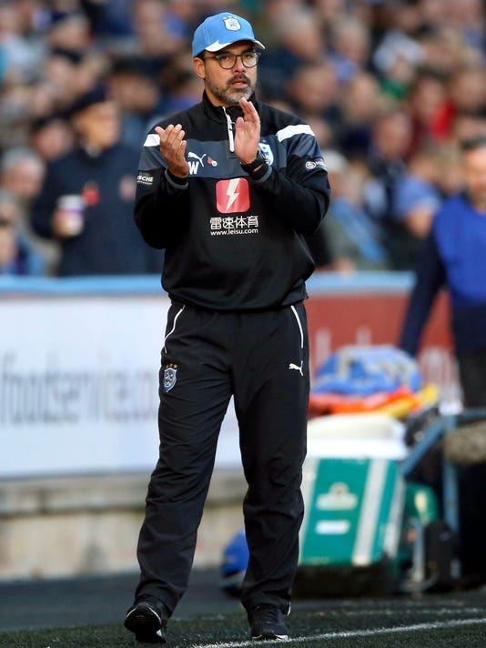 Huddersfield Town manager David Wagner gestures on the touchline during the English Premier League soccer match against West Bromwich Albion at the John Smith's Stadium, Huddersfield, England, Saturday Nov. 4, 2017. (Nigel French/PA via AP)