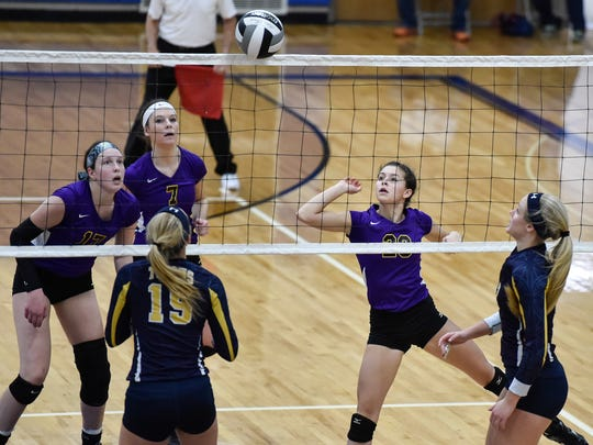 From left: Lexington's  Mackenzie Weaver, Lauren Slaton and Shelby Miller watch as the ball rolls over the net in a return shot against the Ottawa Glandorf Lady Titans. Lady Lex won the match in 4 games to qualify for the final four in Division II.