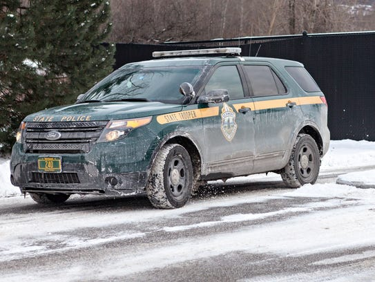 A Vermont State Police trooper departs the barracks in St. Albans to begin a patrol shift in December 2017.