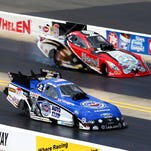 Robert Hight (blue) defeated Chad Head en route to winning the Funny Car event Sunday at the NHRA Carolina Nationals.