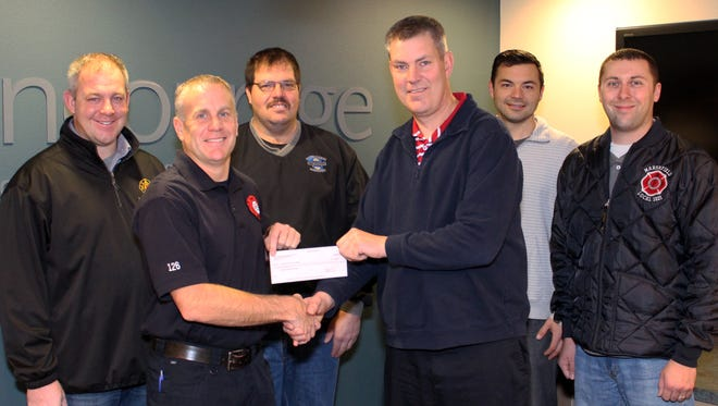 Wisconsin Rapids Fire Fighters Local 425 and Marshfield Fire Fighters Local 1021, with the assistance of the Professional Fire Fighters of Wisconsin Charities, donated $1,000 to the Wood County Fire Chiefs Association. This donation will be used to help fund the new Wood County safety trailer. Pictured are Justin Pluess of Local 425, from left, Derek Matykowski of Local 425, Brad Breuer of Local 1021, Wisconsin Rapids Fire Chief David Kerkman, Ben Goodreau of Local 425 and Lance Christoph of Local 1021.