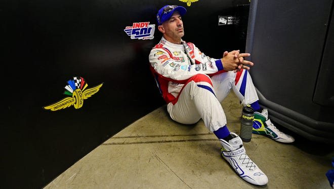 Veteran IndyCar driver Tony Kanaan rests before the 102nd running of the Indianapolis 500 at Indianapolis Motor Speedway.