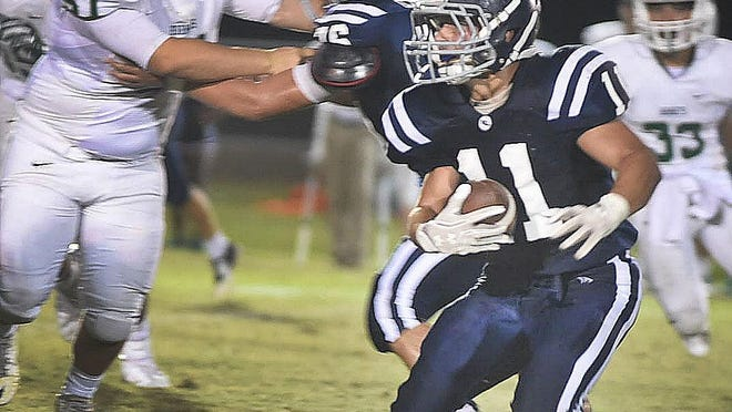 Westminster Christian running back Cole Fournet looks for running room during the Crusaders' district win over Catholic Hihg of Pointe Coupee on Friday.